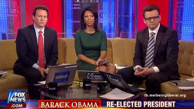 The glum club ... Fox presenters get news of Barack Obama's win.