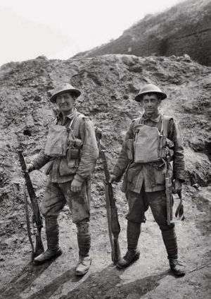 Hard-fought war ... Privates George Giles and John Anderton with their kit as they come out of battle.