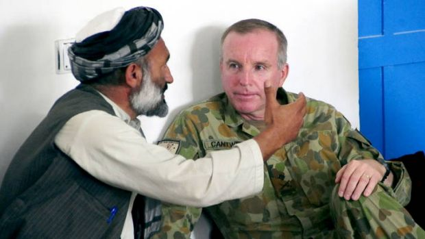 Model major-general … John Cantwell sits down with a village chief in Afghanistan.