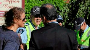 Janine Watson and owner Joel Freeman speak with police.