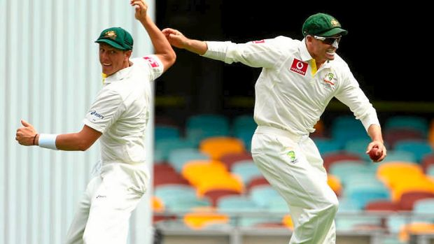 James Pattinson and Michael Hussey of Australia celebrate the wicket of Alviro Petersen.