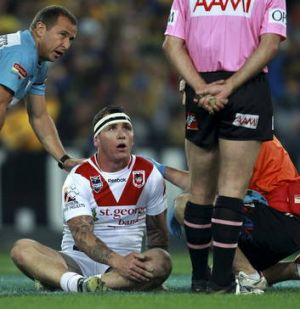 Josh Miller of the Dragons after being hit in a high tackle against the Eels in 2012.