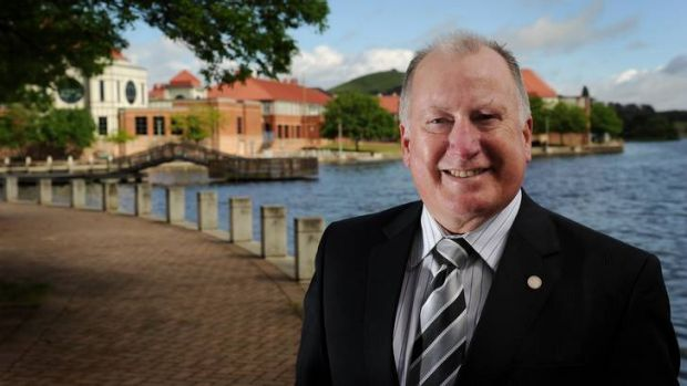 Mick Gentleman stands down by the lake in Tuggeranong.