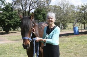 Pegasus executive director Margaret Morton with Tully the horse.