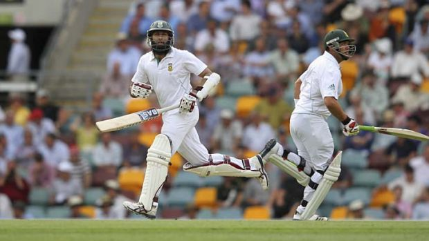 Two up ... Hashim Amla and Jacques Kallis cross for another run on their way to 90 and 84 respectively, as Ricky Ponting ...