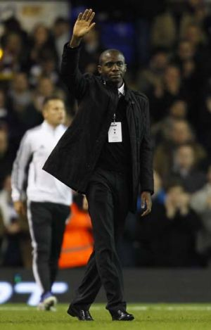 Back from the dead ... Fabrice Muamba is welcomed back to White Hart Lane at half-time during Spurs' Europa League match ...