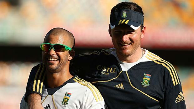 Taken to hospital ... J.P. Duminy with skipper Graeme Smith.