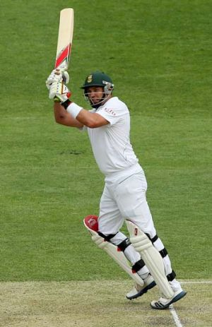 On song: Jacques Kallis dispatches a ball at the Gabba.