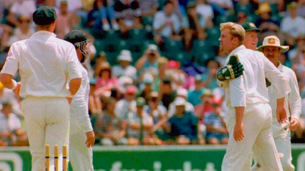 Squaring up: Shane Warne crosses swords with South African batsman Andrew Hudson in 1994.