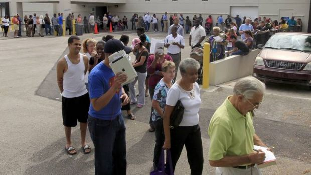 Long lines of voters are shown at the Supervisor of Elections office in West Palm Beach, Florida.