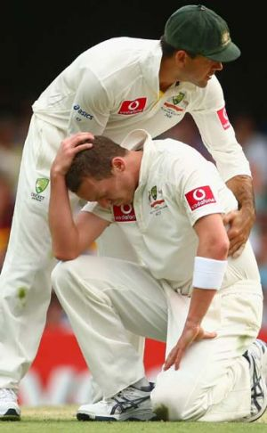 Ouch …Ricky Ponting consoles Peter Siddle.