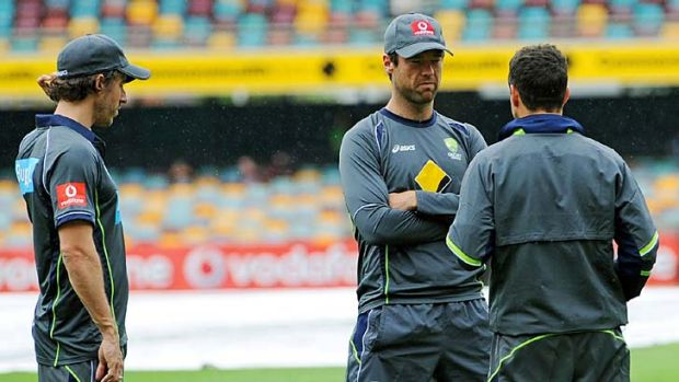Raining men ...  Australian players inspect the Gabba pitch as play is delayed by wet weather on the second day of the ...