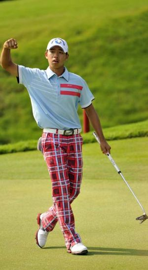 No guts, no glory … Guan Tianlang wins the Asia-Pacific Amateur title with a ''belly'' putter.