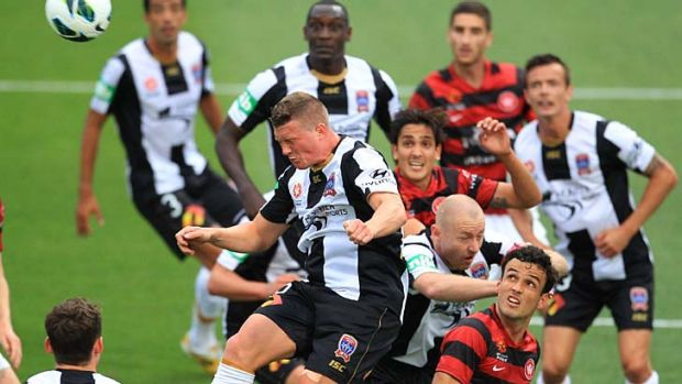 Heads up ... Dominik Ritter wins  a high ball during the Newcastle Jets' come-from-behind victory against the Western ...
