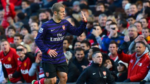 Arsenal's English midfielder Jack Wilshere is sent off during the English Premier League match between Manchester United ...
