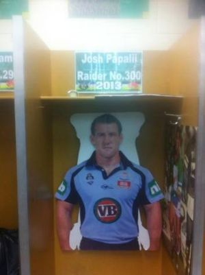 A poster of Cronulla Sharks captain Paul Gallen has been stuck in Josh Papalii's locker.