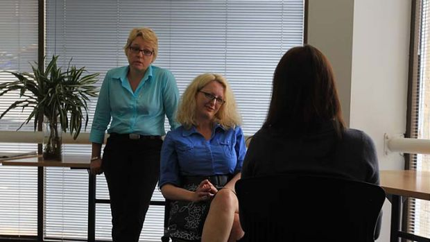 Talk time ... Anita McGregor, far left, supervises Helen Fearnley counsel Sarah.