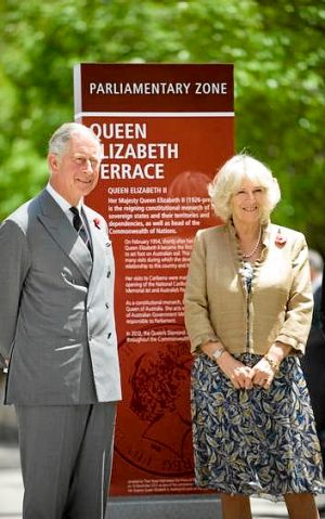 Charles, Prince of Wales and Camilla, Duchess of Cornwall  unveil a plaque during the naming of Queen Elizabeth Terrace.