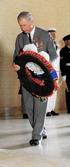 Charles, Prince of Wales lays a wreath on the tomb of the unknown Australian soldier at the Australian War Memorial.