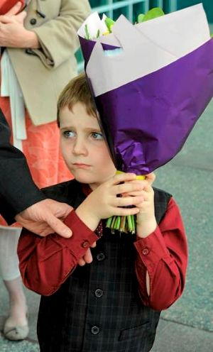 Son of Labor MP Andrew Leigh, 5-year-old Sebastian Leigh, presented flowers to Camilla, Duchess of Cornwall.