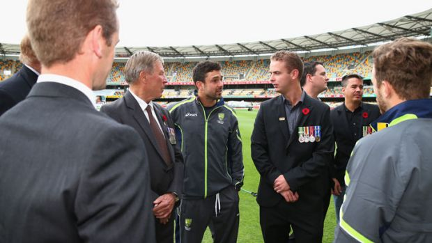 Ed Cowan of Australia meets Australian War Veterans during Remembrance Day on day three of the First Test match between ...