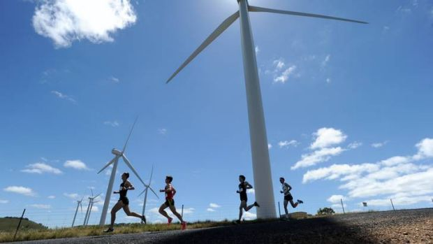 Runners, led by eventual winner, Martin Dent, pass one of the towers.