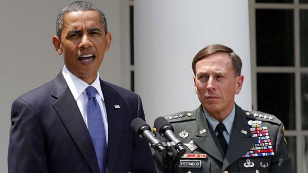 Before the exposure ... General Petraeus, pictured with President Obama before he resigned from his position as CIA director.