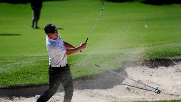 Daniel Bringolf hits out of a bunker on the 18th on his way to winning the Federal Amatuer Golf Open.