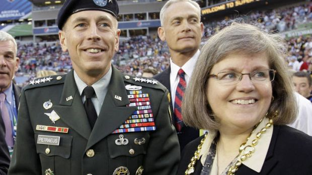 General David Petraeus stands with his wife Holly before the NFL Super Bowl.