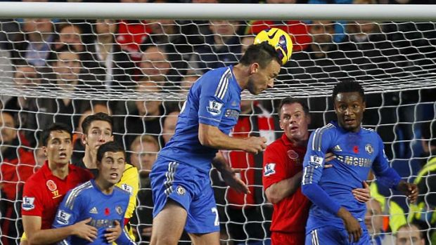 Chelsea defender John Terry scores the opening goal with a header.