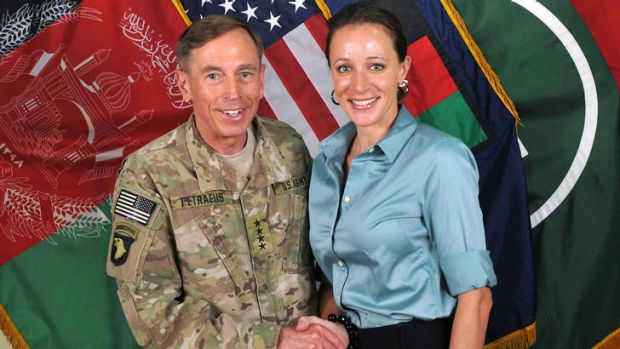 General Davis Petraeus, left, shaking hands with Paula Broadwell, his biographer.