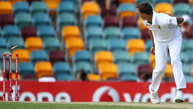 No one home: South African paceman Dale Steyn looks on as his deflection runs out Ed Cowan at the non-striker's end.