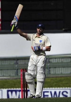 Canberra's David Dawson celebrates a century for the NSW second XI at Manuka Oval earlier this year. Dawson is about to ...