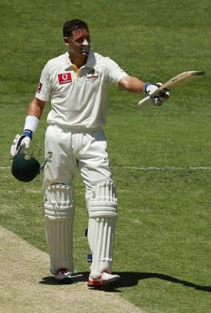 Mike Hussey acknowledges the crowd after notching another century.