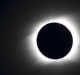 The sun is seen partially covered by the moon on Easter Island, 3700 km off the Chilean coast in the Pacific Ocean, on ...