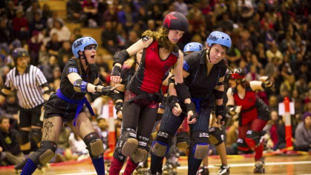 Roller Derby bout between the Red Bellied Black Hearts and the Black 'n' Blue Belles.