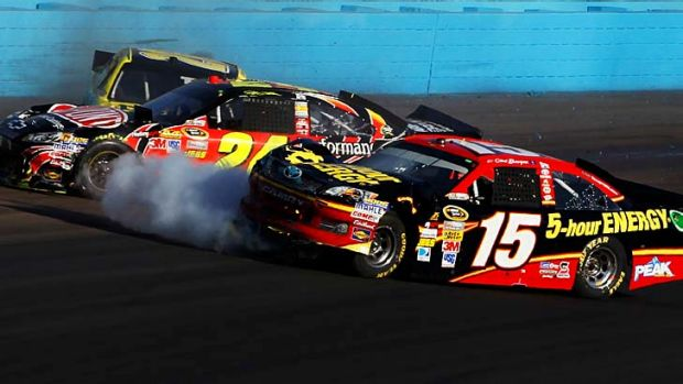 Clint Bowyer (right) and Jeff Gordon collide on the track during the NASCAR Sprint Cup Series AdvoCare 500 at Phoenix ...