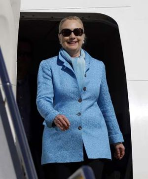 US Secretary of State Hillary Clinton steps off a US Air Force jet in Perth on Tuesday as she arrives for defence talks.