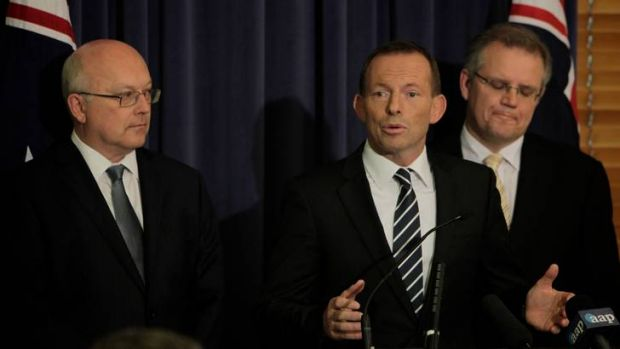 Shadow Attorney-General George Brandis with Opposition Leader Tony Abbott and Shadow Immigration Minister Scott Morrison.