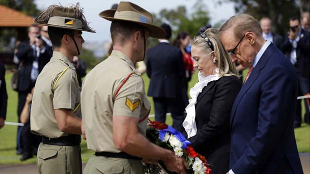 US Secretary of State Hillary Clinton and Australian Foreign Minister Bob Carr take part in a wreath-laying ceremony at ...
