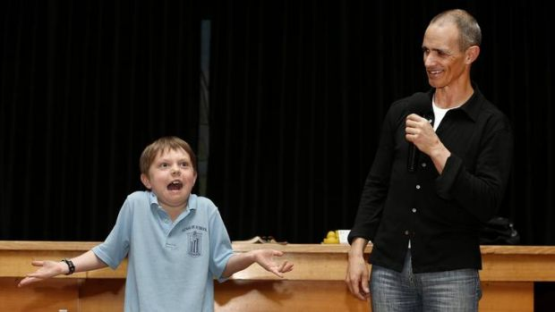 Ainslie School year 2 student Taj Whitney-Nash helps author Andy Griffiths demonstrate what happens when you shrug your ...