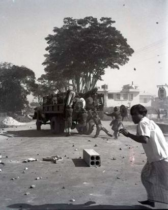 Police flee the scene on the face of an angry mob during the mass uprising of 1969 in Dhaka. 1969.