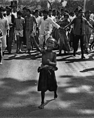 A street child or tokai leads a procession during the mass uprising of 1969. Police bullets killed the child soon after ...