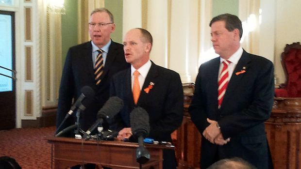 Deputy Premier Jeff Seeney, Premier Campbell Newman and Treasurer Tim Nicholls front the media at Parliament today.