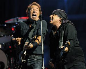 Bruce Springsteen, left, performs with Steven Van Zandt.