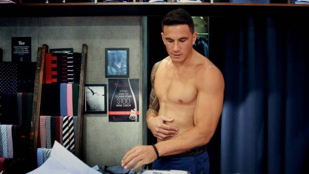 Sonny Bill Williams suits up for his Sydney Roosters press conference on Tuesday.