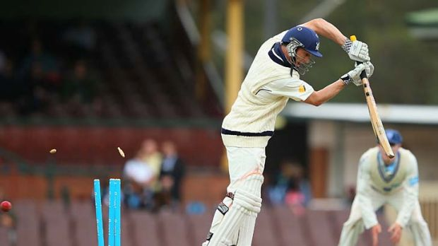 Mitchell Starc (not in pic) gets through David Hussey's defence.