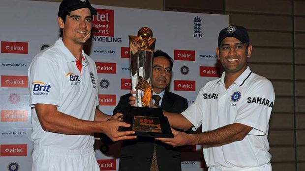 England captain Alastair Cook and his Indian counterpart, Mahendra Singh Dhoni, pose with the trophy which will be ...