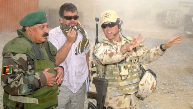 ADF Major Paul Foura (right) shows Afghan National Army Brigadier General, Gul Aqa Naibi around Forward Operating Base ...