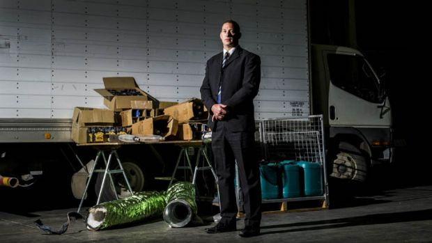 Detective Sergeant Shane Scott with some of the hydroponic equipment found dumped at Kaleen High School.